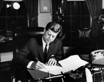 2012-10-22-October_23_1962_President_Kennedy_signs_Proclamation_3504_authorizing_the_naval_quarantine_of_Cuba